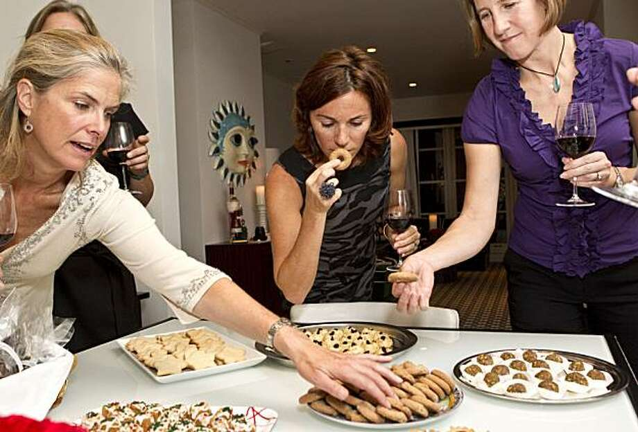 Tori Ritchie, CC Sofronas and Katie Hansen (left to right) taste one of the cookie creations at an annual holiday cookie swap party in San Francisco, Calif., on Thursday, October 7, 2010. Photo: Laura Morton, Special To The Chronicle