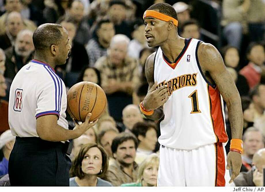 State Warriors guard Stephen Jackson (1), right, argues with Derek Richardson in the fourth quarter of an NBA basketball game on Monday, Dec. 3, 2007, in Oakland, Calif. The Magic won 123-117 in overtime. Jackson's arrival in Golden State last season helped turned the Warriors from a sorry franchise that had missed the playoffs for 12 straight seasons into a team that went on a magical playoff run. His return from a seven-game suspension to open this season has had similar results, as the Warriors have overcome an 0-6 start without Captain Jack to get right back to the groove they were in to end last season. (AP Photo/Jeff Chiu) Ran on: 12-14-2007 Stephen Jackson says he's learning to laugh off foul trouble, and getting tossed from games less. Ran on: 12-14-2007 Stephen Jackson says he's learning to laugh off foul trouble, and getting tossed from games less. Photo: Jeff Chiu, AP