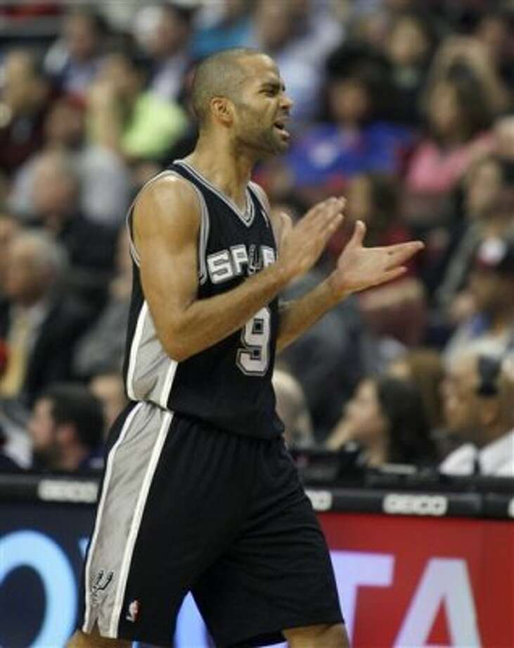 San Antonio Spurs' Tony Parker celebrates after scoring against the Philadelphia 76ers in the second half of an NBA basketball game on Wednesday, Feb., 8, 2012, in Philadelphia. The Spurs won 100-90. (AP Photo/H. Rumph Jr ) (AP)