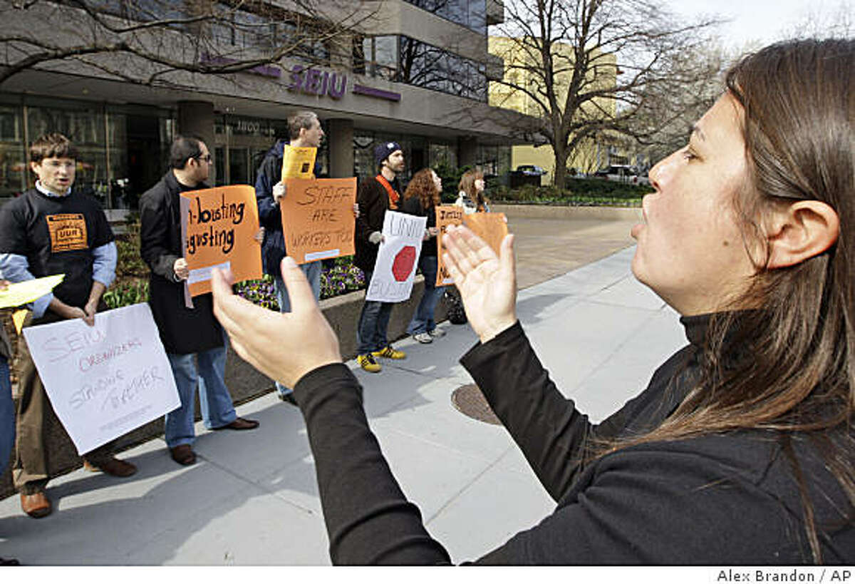 Sarah Solis, right, cheers with other union employees who are picketing their own union, claiming it is unfairly laying off 75 union organizers, Friday, March 27, 2009, Washington. (AP Photo/Alex Brandon)