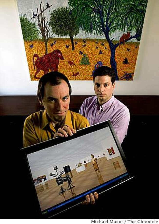 """Virtual Gallery"", a company founded by, Jantje Boichel, (left) chief technology officer and Jordan Klineman, company president,  with an on-screen sample of their product that uses 3-D virtual environments for art museums to plan exhibits.  At their office in downtown  San Francisco, Calif. on Wednesday Mar. 18, 2009. Photo: Michael Macor, The Chronicle"