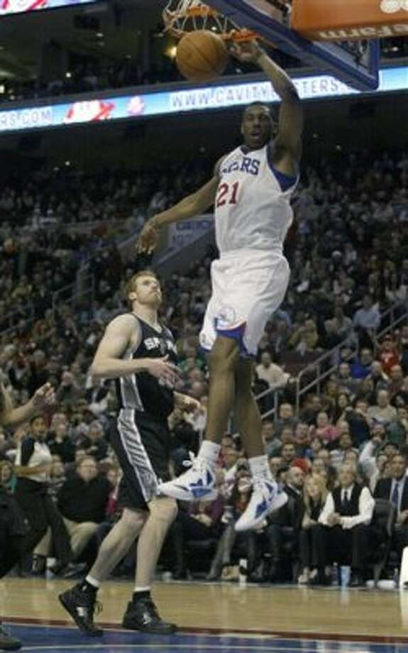 Philadelphia 76ers' Thaddeus Young (21)  scores against the San Antonio Spurs in the second half of an  NBA basketball game on Wednesday, Feb., 8, 2012, in Philadelphia. The Spurs won 100-90. (AP Photo/H. Rumph Jr) (AP)
