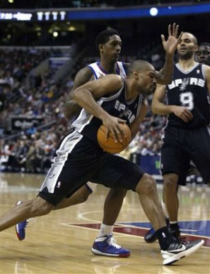 San Antonio Spurs' Gary Neal, , front left, drives against  Philadelphia 76ers' Lou Williams, behind, in the second half of an  NBA basketball game on Wednesday, Feb., 8, 2012, in Philadelphia. The Spurs won 100-90. (AP Photo/H. Rumph Jr ) (AP)