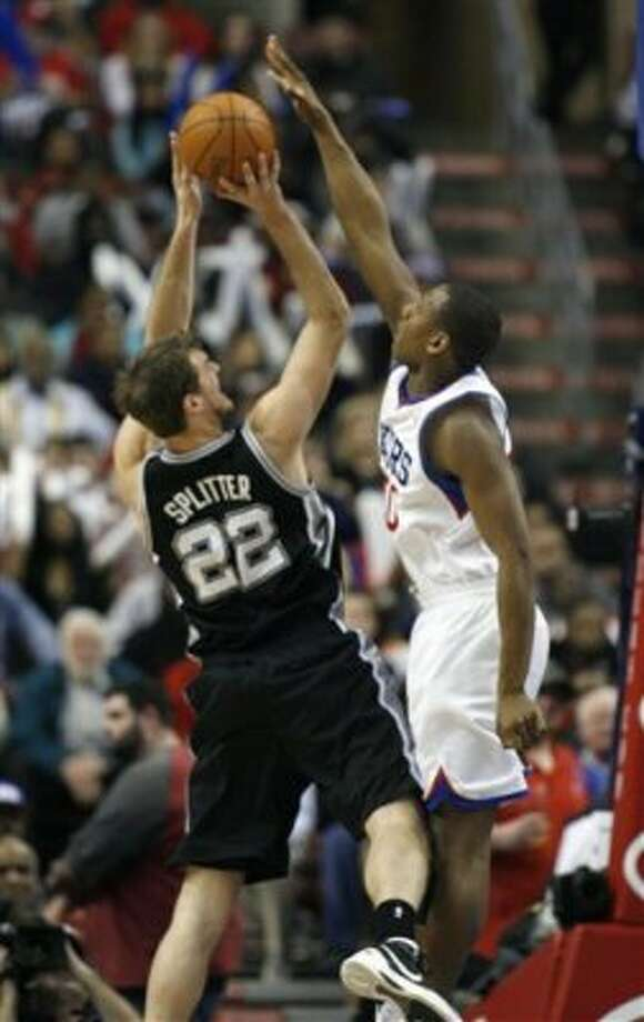 San Antonio Spurs' Tiago Splitter (22) has his shot blocked by  Philadelphia 76ers' Lavoy Allen in the second half of an NBA basketball game on Wednesday, Feb., 8, 2012, in Philadelphia. The Spurs won 100-90. (AP Photo/H. Rumph Jr ) (AP)