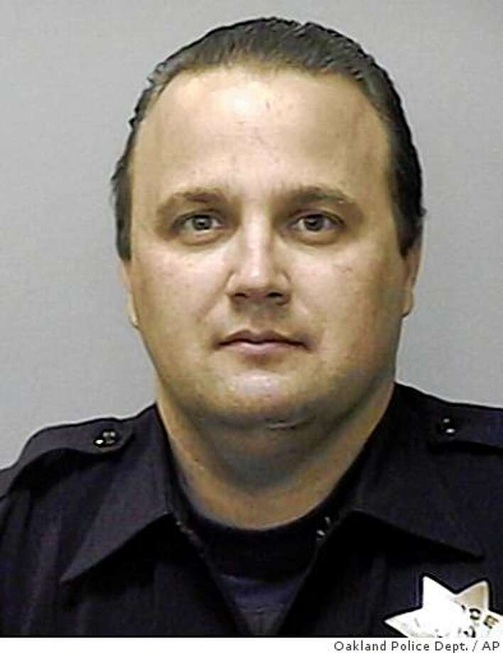 This is an undated photo released by the Oakland Police Department of Oakland Police officer John Hege. A man wanted for violating his parole killed three police officers and gravely wounded Hege in two shootings Saturday, March 21, 2009, the first after a routine traffic stop and the second after a massive manhunt ended in gunfire, authorities said. The gunman was also killed. (AP Photo/Oakland Police Department) Photo: Oakland Police Dept., AP