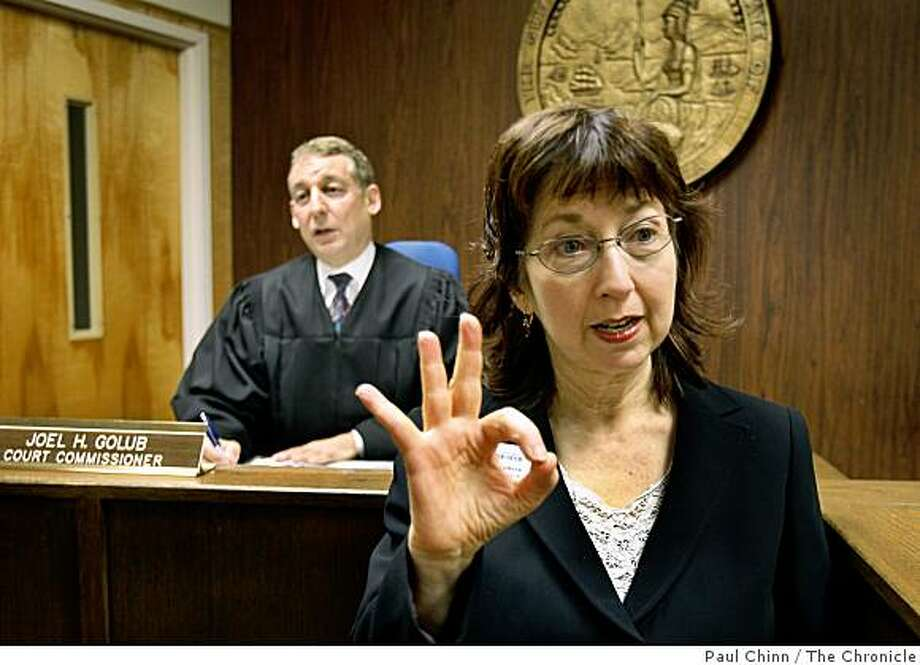 Anna Mindess translates for the hearing impaired in Commissioner Joel Golub's courtroom in Walnut Creek, Calif., on Friday, March 20, 2009. Photo: Paul Chinn, The Chronicle