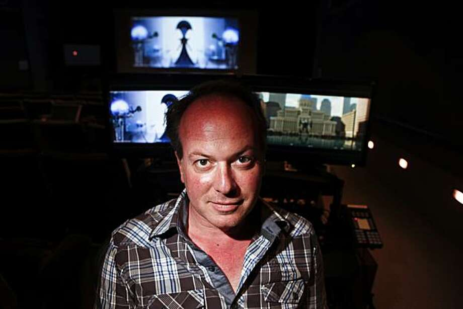 "Tom McGrath, seen in a screening room in the Dreamworks Redwood City, Calif., campus on Friday, Oct. 1, 2010, is the director of their new film ""Megamind."". Photo: Russell Yip, The Chronicle"