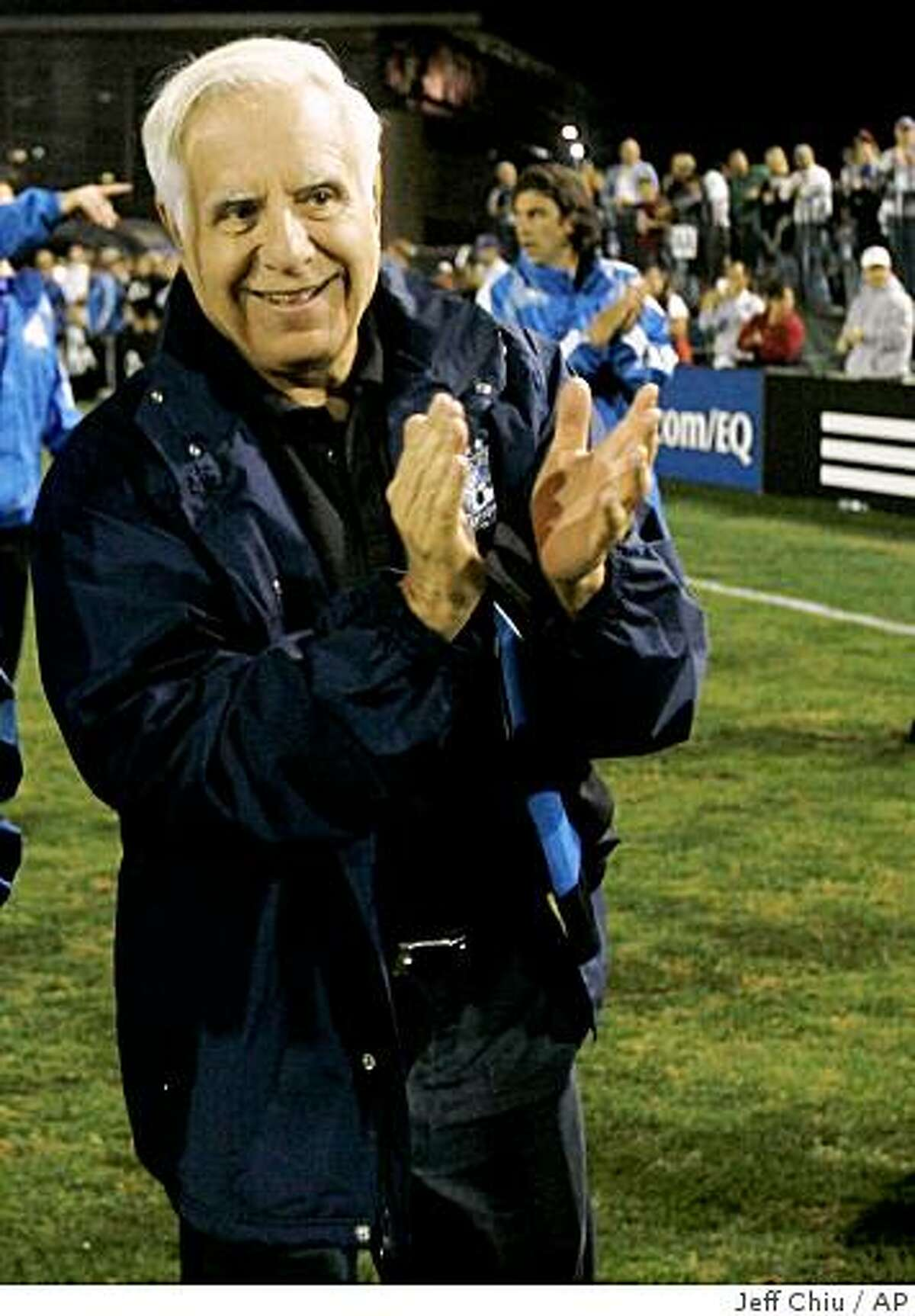 San Jose Earthquakes head coach Frank Yallop, left, and owner Lew Wolff walks on the field after beating Toronto FC in an MLS soccer match in in Santa Clara, Calif., Saturday, Oct. 25, 2008. The Earthquakes won 2-0. (AP Photo/Jeff Chiu)