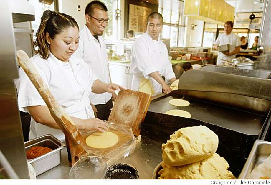 Irma Bacab (left) making tortillas from the cornmeal dough from the corn grinder at Nopalito restaurant in San Francisco, Calif., on March 17, 2009. Chefs Jose Ramos (middle) and Gonzalo Guzman (right) are next to Irma Bacab. Photo: Craig Lee, The Chronicle