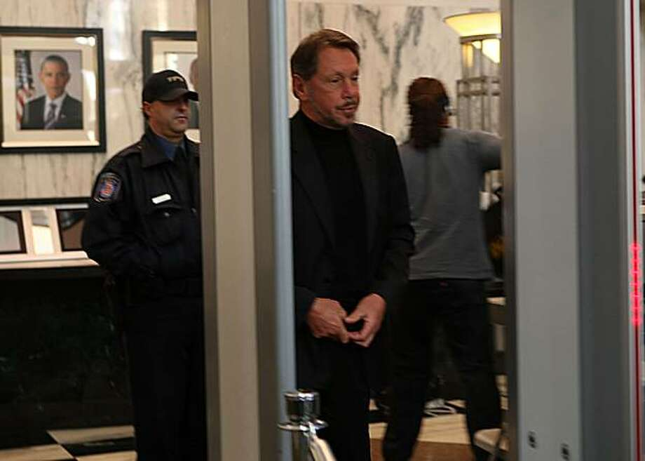 Oracle CEO Larry Ellison going through security at the US District Court building in Oakland, Calif., to testify at the federal jury trial of Oracle vs. SAP on Monday, November 8, 2010. Photo: Liz Hafalia, The Chronicle
