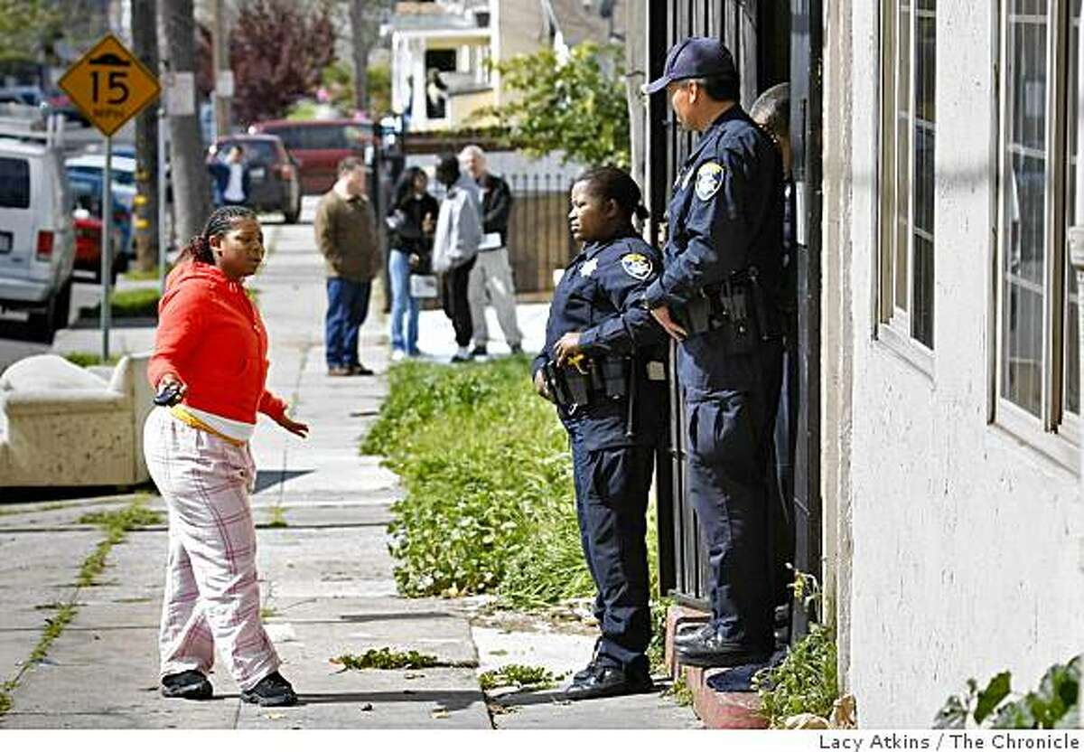 Destiny Banks pleads with police officers not knowing if her friend Lovelle Mixon is dead or alive, Sunday March 22, 2009, in Oakland, Calif., outside the apartment where he was killed on Saturday