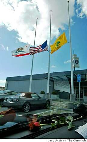 Flags fly at half staff at the Eastmont Police Substation, Sunday March 22, 2009, in Oakland, Calif. for the police officers that were killed Saturday. Photo: Lacy Atkins, The Chronicle