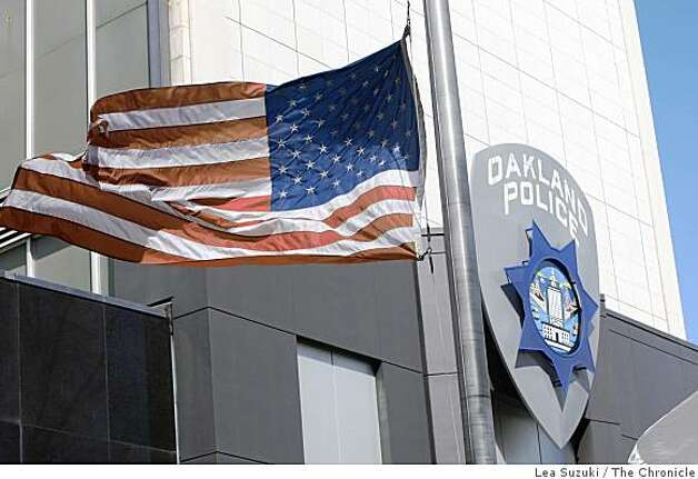 Flags outside of Oakland Police Department Headquarters flew at half-mast in Oakland, Calif. on Sunday, March 22, 2009, following the deaths of four OPD officers in the line of duty. Photo: Lea Suzuki, The Chronicle