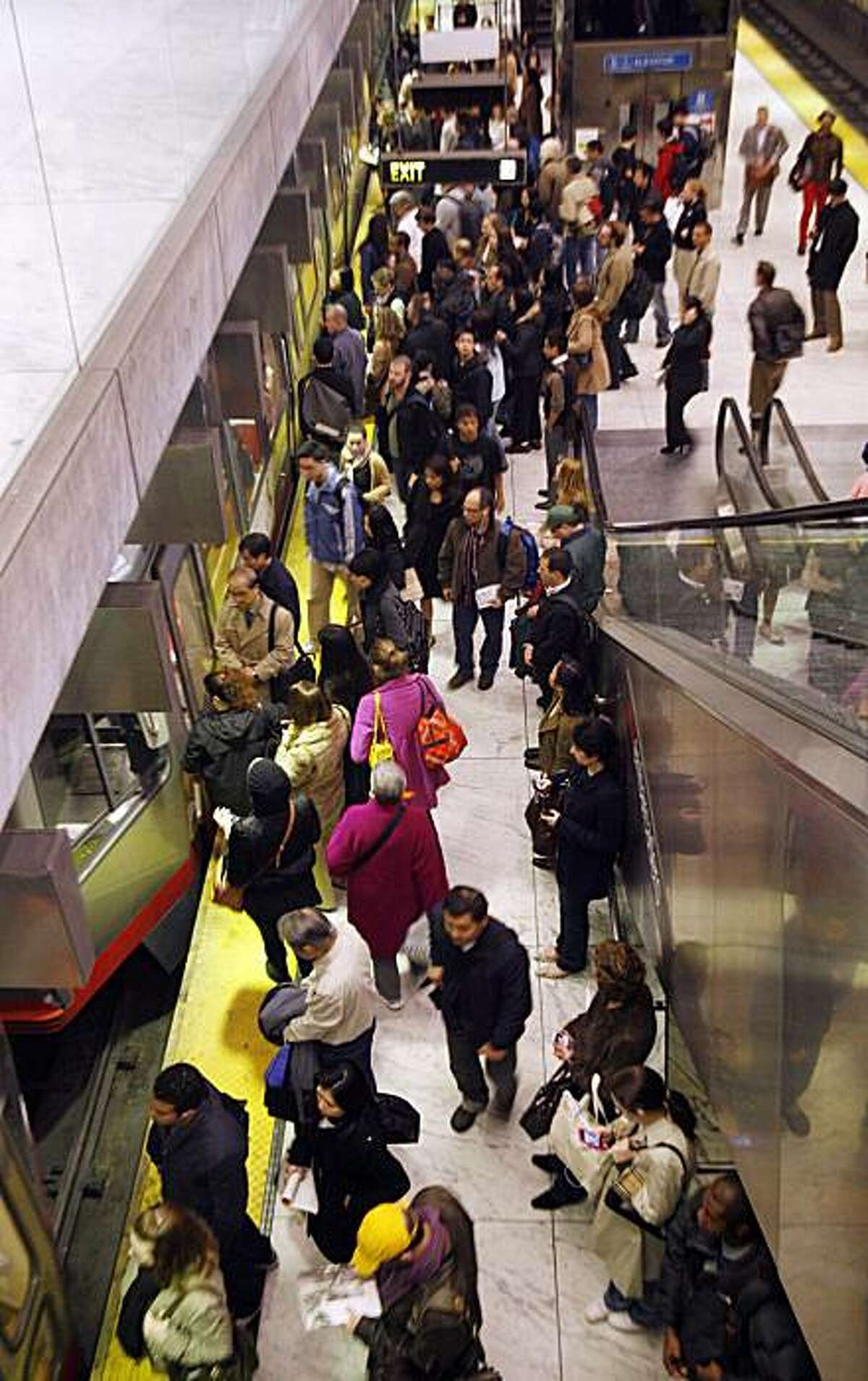 Commuters wait for a MUNI train at the Montgomery Street station in San Francisco, Calif., on Friday, February 20, 2009. Attempts to get more people out of their cars have fallen short, despite strong arguments from advocates who say alternatives to driving are good for the environment.