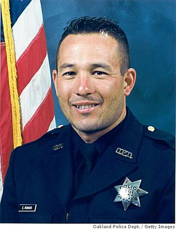 OAKLAND, CA - UNDATED:  In this handout image provided by the Oakland Police Department , Oakland Police Sgt. Ervin Romans is seen in this undated image in Oakland, California. Sgt. Romans was one of three Oakland police officers to be killed during a traffic stop and standoff with a gunman while another officer remains in critical condition. The suspect was also shot and killed by police.  (Photo by Oakland Police Department via Getty Images) Photo: Oakland Police Dept., Getty Images