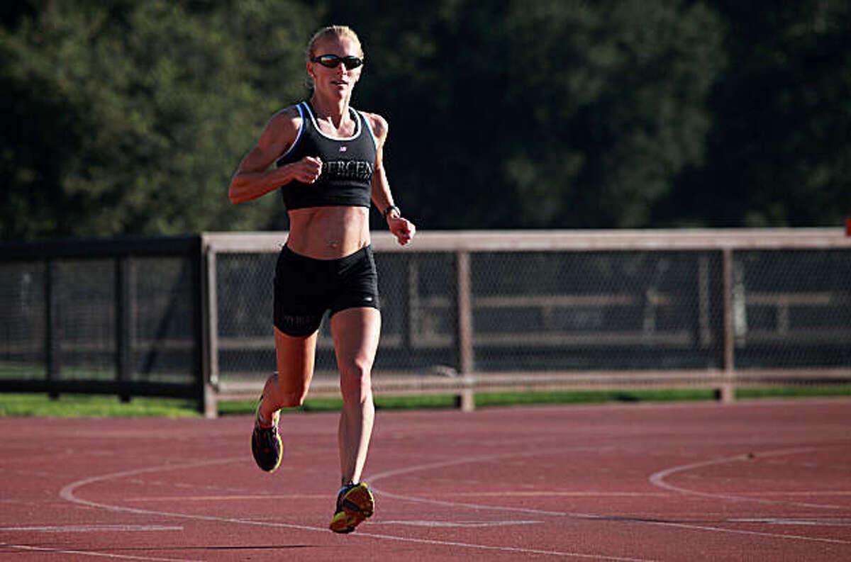 Rachel Booth doing her regular morning run at the Stanford Track in Palo Alto, Calif., on Wednesday, November 3, 2010.