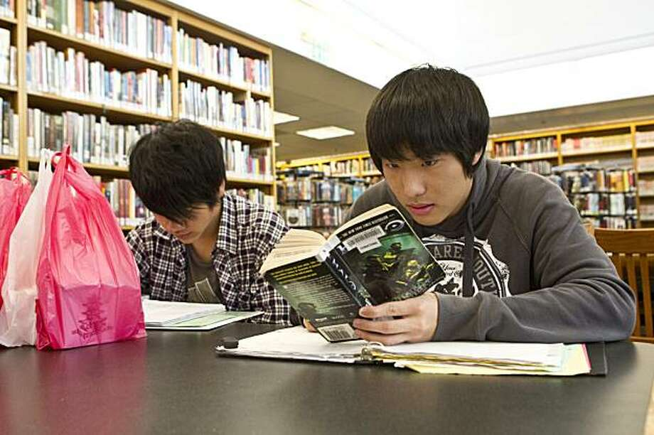Zekang Zhang (left) and Zhuojun Chen study at the Chinatown Branch Library in San Francisco, Calif., on Wednesday, November 3, 2010.  The Library Commission is voting on whether to rename the library in honor of Him Mark Lai, a Chinese American historian. Photo: Laura Morton, Special To The Chronicle