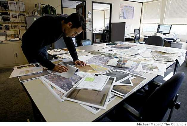 Robin Grossinger, with a table full of maps and documents that he uses in his research at his Oakland, Calif. offices, on Wednesday Feb. 25, 2009,. Grossinger, is a historical ecologist at the San Francisco Estuary Institute. Photo: Michael Macor, The Chronicle
