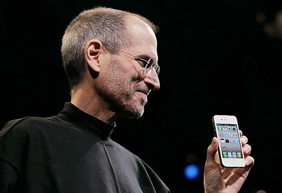SAN FRANCISCO - JUNE 07:  (FILE PHOTO)  Apple CEO Steve Jobs holds the new iPhone 4 after he delivered the opening keynote address at the 2010 Apple World Wide Developers conference June 7, 2010 in San Francisco, California. Apple announced October 18, 2010 profits of $4.31 billion on revenues of $20.3 billion for the quarter. Photo: Justin Sullivan, Getty Images