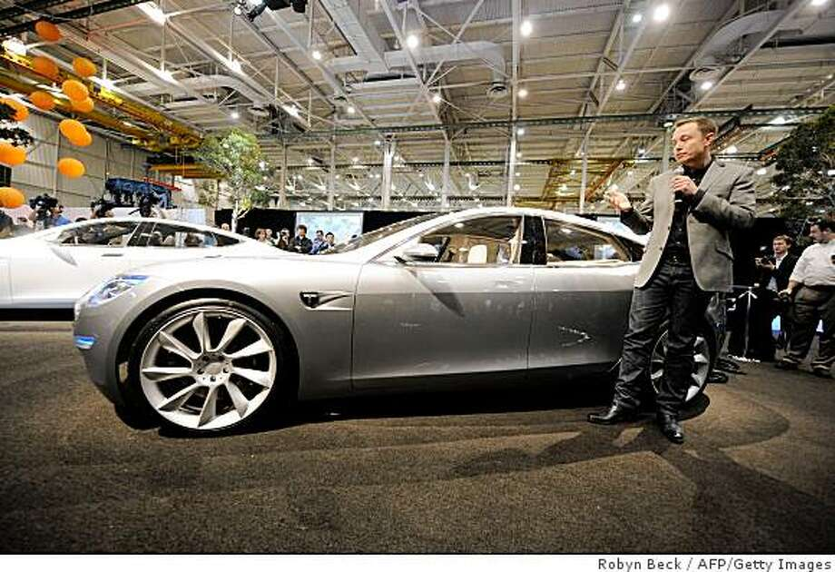 Tesla Motors Chairman and CEO Elon Musk introduces the new Tesla Model S all-electric sedan in Hawthorne, California on March 26, 2009.  Musk said the state-of-the-art, five-seat sedan will be the world's first mass-produced, highway-capable electric car.  The car has an anticipated base price of 57,400 US dollars but will cost less than 50,000 after a federal tax credit of 7,500 dollars.   AFP PHOTO / Robyn BECK (Photo credit should read ROBYN BECK/AFP/Getty Images) Photo: Robyn Beck, AFP/Getty Images