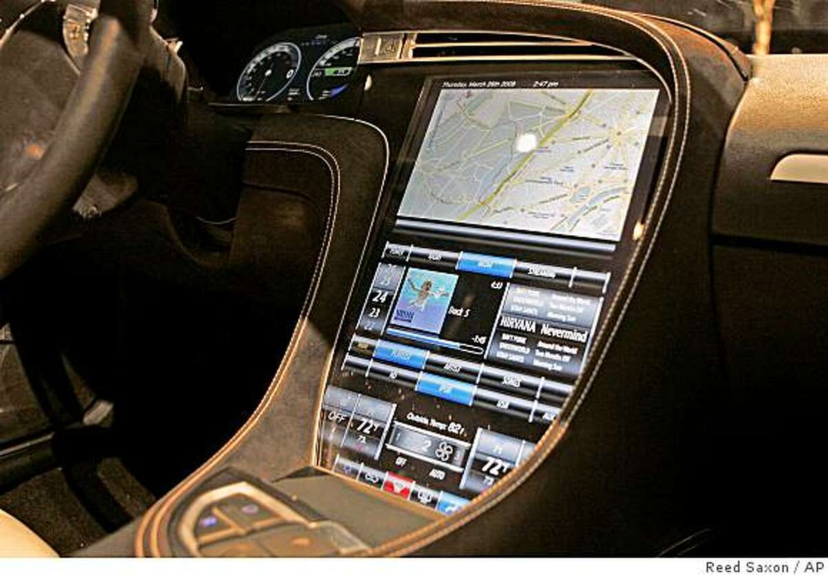 The touch-screen control panel of the prototype Tesla Model S all-electric 5-door sedan is seen after its unveiling in Hawthorne, Calif., Thursday, March 26, 2009. (AP Photo/Reed Saxon)