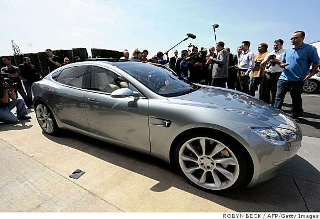 palo alto little league is raffling off a tesla sfgate media gather around the new tesla model s all electric sedan at the car s