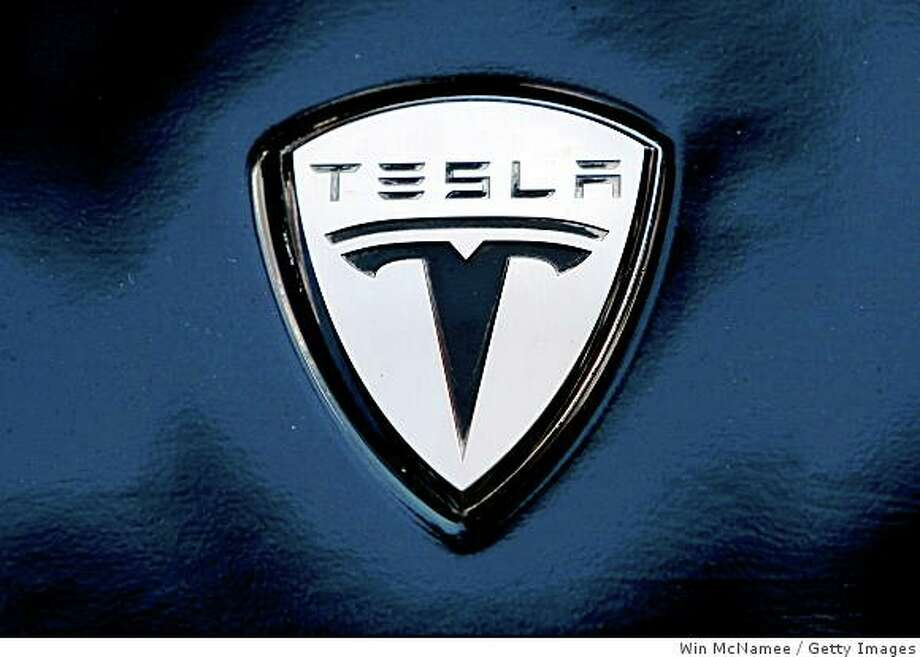 WASHINGTON - JUNE 12:  The Tesla electric car logo is shown during a display of alternative energy vehicles on Capitol Hill June 12, 2008 in Washington, DC. As part of the event, Sen. Harry Reid (D-NV) and other members of Congress spoke out on the need to develop new technologies that can help reduce U.S. dependence on oil.   (Photo by Win McNamee/Getty Images) Photo: Getty Images
