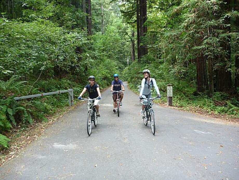 Chandell Beeson, Aluxa Lalicker and Ian Garcia ride electric-assist bikes near the town of Olema, about six miles from where they rented them at Point Reyes. Photo: John Granatir