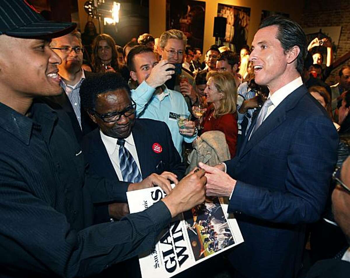 Mayor Gavin Newsom (right), Democratic candidate for lieutenant governor, signs a World Series edition of the Chronicle for a supporter at an election night rally in San Francisco, Calif., on Tuesday, Nov. 2, 2010.