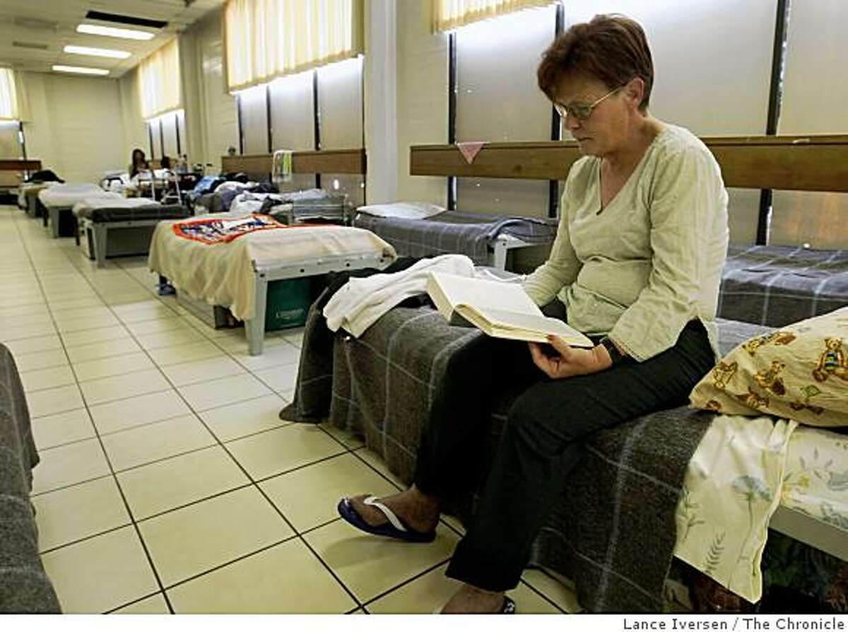 Linda Bernal who has been homeless for a month due to medical reasons passes time at the Next Door shelter run by Episcopal Community Services at 1001 Polk Street Wednesday, March 25, 2009 reading a Stephen King book of short stories. One cost cutting proposal offered by San Francisco officials is the closing of shelters like Next Door during the day.