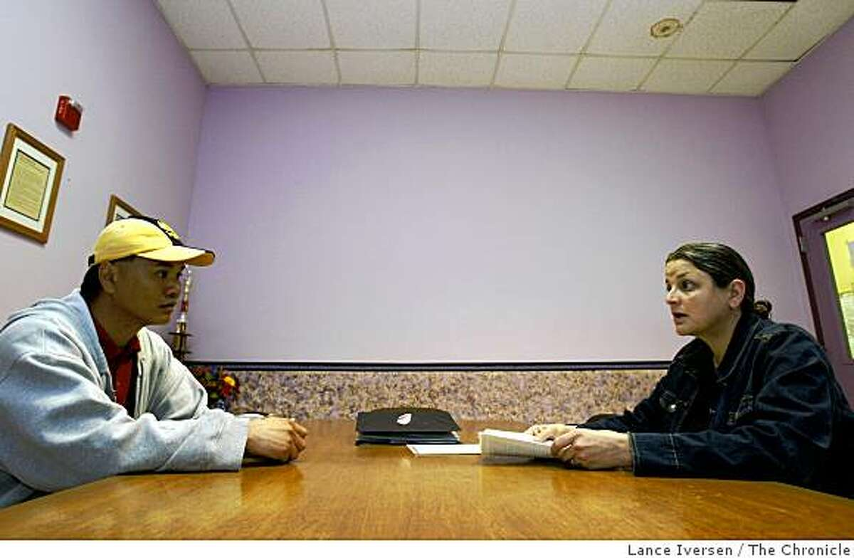 Truong Nguyen who is homeless is counseled by Allison Smith at the Next Door shelter run by Episcopal Community Services at 1001 Polk Street Wednesday, March 25, 2009.