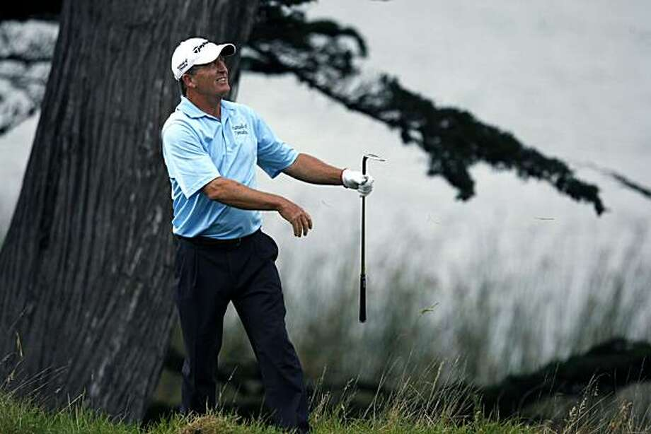 Fred Funk watches his second shot on the 18th hole come up short of the green during round two of the Schwab Cup Championship Friday Nov. 5, 2010 at San Francisco's Harding Park Golf Course. Funk who was a co leader doubled bogie the hole. Photo: Lance Iversen, San Francisco Chronicle