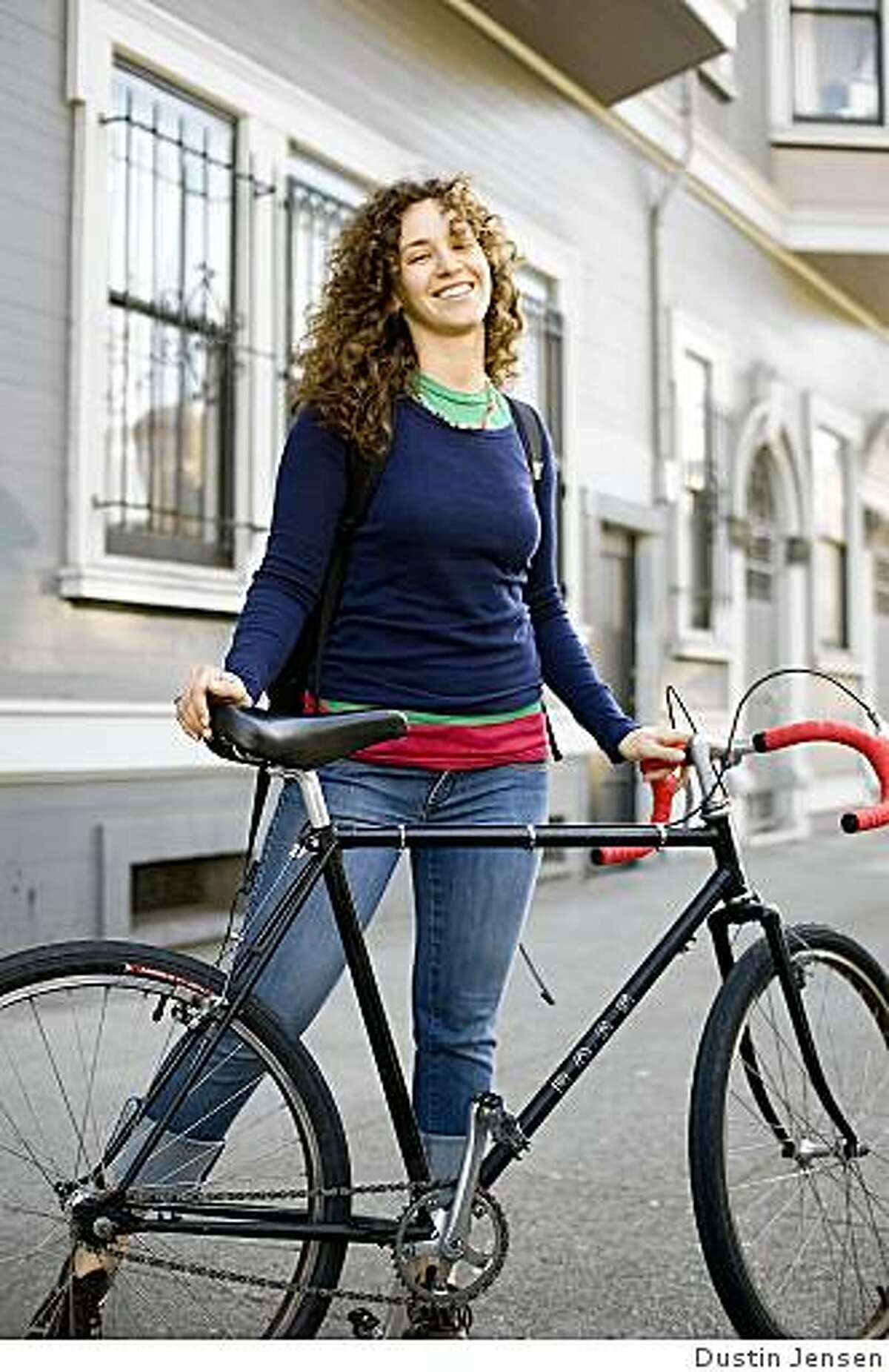 Jessica Collier and her all-black, single-speed, lug-steel Ross frame.