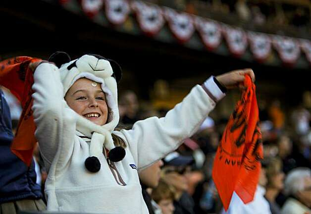8-year-old Elsa Stuart, of Mill Valley,  cheers on the San Francisco Giants as they went on to beat the Philadelphia Phillies 3-0 in game 3 of the National League Championship Series, on Tuesday Oct. 19, 2010 at AT&T Park, in San Francisco, Calif. Photo: Michael Macor, The Chronicle