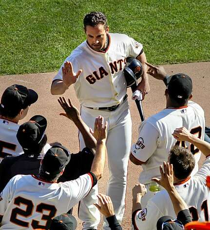 Giants Pat Burrell celebrates his run scored on an Aubrey Huff single in the fourth inning, as the San Francisco Giants went on to beat the Philadelphia Phillies 3-0 in game 3 of the National League Championship Series, on Tuesday Oct. 19, 2010 at AT&T Park, in San Francisco, Calif. Photo: Michael Macor, The Chronicle