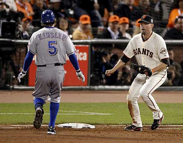 Ian Kinsler (left) is tagged out in the 8th inning by Aubrey Huff after Kinsler over ran the base on an infield hit. The San Francisco Giants defeated the Texas Rangers 11-7 in the first game of the 2010 World Series. Photo: Brant Ward, San Francisco Chronicle
