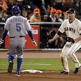 Ian Kinsler (left) is tagged out in the 8th inning by Aubrey Huff after Kinsler over ran the base on an infield hit. The San Francisco Giants defeated the Texas Rangers 11-7 in the first game of the 2010 World Series.