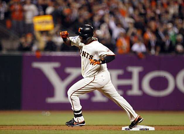 Edgar Renteria heads to third on a fielding error by Vladimir Guerrero in the eighth inning. Renteria scored on a double by Travis Ishikawa. The San Francisco Giants played the Texas Rangers at AT&T Park in San Francisco, Calif., in Game 1 of the World Series on Wednesday, October 27, 2010. The Giants defeated the Rangers 11-7 Photo: Carlos Avila Gonzalez, The Chronicle