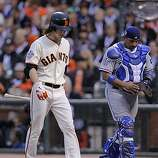 Giants Tim Lincecum walks back to the dugout after an attempted bunt flew out to catcher Bengie Molina in the third as the San Francisco Giants take on the Texas Rangers in Game 1 of the World Series at AT&T Park in San Francisco, Calif., on Wednesday, October 27, 2010.