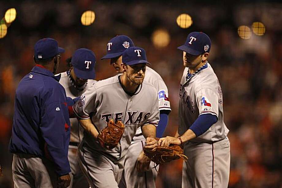 Rangers Cliff Lee leaves the mound after being relieved in the fifth inning.  He gave up 3 runs in the inning to give the Giants a 5-2 lead. The San Francisco Giants take on the Texas Rangers in Game 1 of the World Series at AT&T Park in San Francisco, Calif., on Wednesday, October 27, 2010. Photo: Carlos Avila Gonzalez, The Chronicle