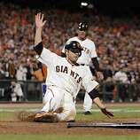 Freddy Sanchez scores on a single by Nate Schierholtz in the eighth inning. The San Francisco Giants played the Texas Rangers at AT&T Park in San Francisco, Calif., in Game 1 of the World Series on Wednesday, October 27, 2010. The Giants defeated the Rangers 11-7