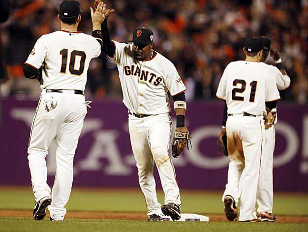 Giants Travis Ishikawa, left, and Juan Uribe celebrate after the game. The San Francisco Giants played the Texas Rangers at AT&T Park in San Francisco, Calif., in Game 1 of the World Series on Wednesday, October 27, 2010. The Giants defeated the Rangers 11-7 Photo: Carlos Avila Gonzalez, The Chronicle