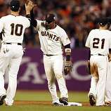 Giants Travis Ishikawa, left, and Juan Uribe celebrate after the game. The San Francisco Giants played the Texas Rangers at AT&T Park in San Francisco, Calif., in Game 1 of the World Series on Wednesday, October 27, 2010. The Giants defeated the Rangers 11-7