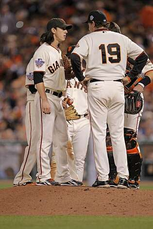 Giants Tim Lincecum talks with pitching coach Dave Righetti on the mound before being taken out in the sxth as the San Francisco Giants take on the Texas Rangers in Game 1 of the World Series at AT&T Park in San Francisco, Calif., on Wednesday, October 27, 2010. Photo: Michael Macor, San Francisco Chronicle