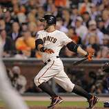 Giants Cody Ross hits an RBI single, scoring Freddy Sanchez, in the fifth inning as the San Francisco Giants take on the Texas Rangers in Game 1 of the World Series at AT&T Park in San Francisco, Calif., on Wednesday, October 27, 2010.