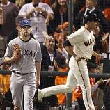 Ranger's pitcher Cliff Lee gives up the third run of the fifth inning as Giant's Pat Burrell passes in the background in Game One of the World Series with San Francisco Giants vs. Texas Rangers at AT&T park in San Francisco, Calif., on Wedneday, October 27, 2010.