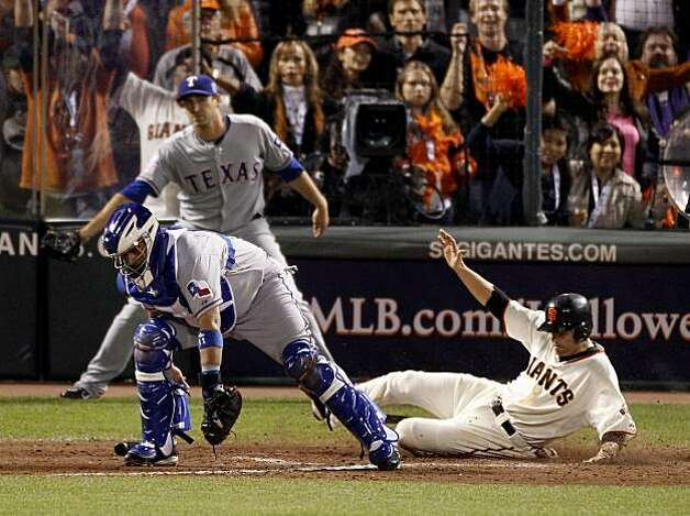 Freddy Sanchez slides home for the Giants 11th run in the 8th inning. Bengie Molina is the catcher. The San Francisco Giants defeated the Texas Rangers 11-7 in the first game of the 2010 World Series. Photo: Brant Ward, San Francisco Chronicle