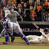 Freddy Sanchez slides home for the Giants 11th run in the 8th inning. Bengie Molina is the catcher. The San Francisco Giants defeated the Texas Rangers 11-7 in the first game of the 2010 World Series.