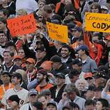 Giants fans display their signs during the game as the San Francisco Giants take on the Texas Rangers in Game 1 of the World Series at AT&T Park in San Francisco, Calif., on Wednesday, October 27, 2010.