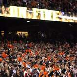 Freddy Sanchez returns to the dugout after scoring on a single to center by Nate Schierholtz in the eighth inning. The San Francisco Giants played the Texas Rangers at AT&T Park in San Francisco, Calif., in Game 1 of the World Series on Wednesday, October 27, 2010. The Giants defeated the Rangers 11-7